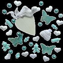 Mix geboortedecoratie in het wit en turquoise